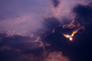 The sky has a cloud covering the sun's rays as a beautiful lobes.