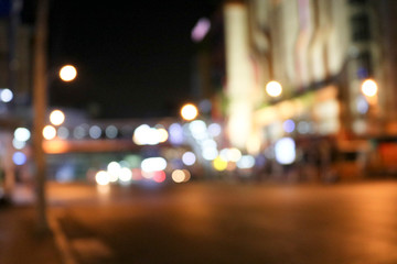 Blurred background night city street, carriageway, car lights. Travel concept: Bokeh light