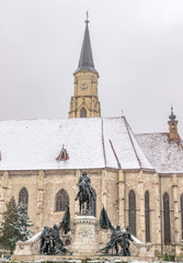St. Michael's Church and Matthias Corvinus Monument during winter in the city center of Cluj-Napoca, Romania