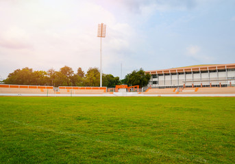 Green grass sports outdoor football field with running track Athletics in the stadium