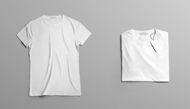 Mockup of two blank t-shirt on a gray studio background.