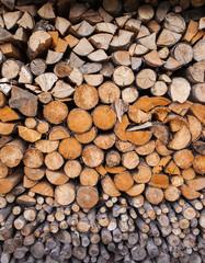 Photo sur Aluminium Texture de bois de chauffage Beautifully folded wooden blocks lie under a canopy