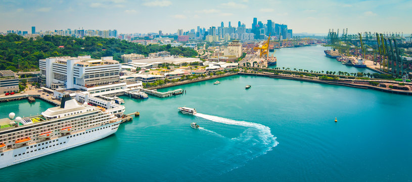 Panoramic harbor landscape of Singapore. Cruise ship in port.