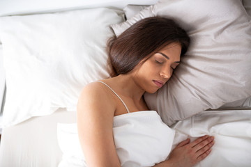 Brown haired beauty sleeping on the bed