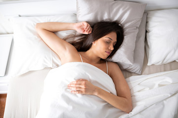 - Young college lady sleeping and dreaming