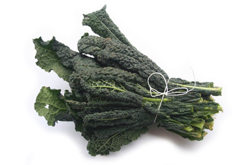 Italian black kale leaves isolated on white background. Brassica oleracea 'Lacinato' vegetable