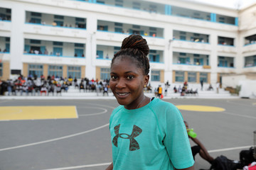 Khady Camara, a basketball player who will be voting for the first time on February 24, poses for a photograph during her training session at Cheikh Anta Diop University in Dakar