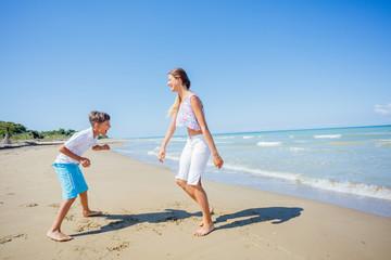 Happy kids having fun on tropical beach