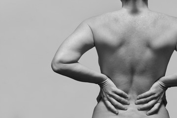 close up of middle aget woman with low back pain