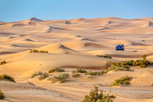 Vintage open top 4x4 SUV in the desert in Dubai, United Arab Emirates