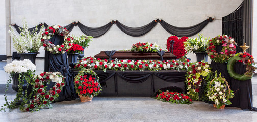 Funeral, coffin, decorated with wreaths, in the farewell hall, panorama. Sadness, eternal memory. Wall mural