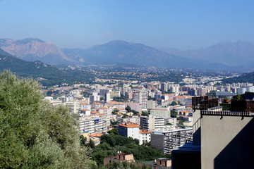 Corsica.Modern areas of the city of Ajaccio with the mountains surrounding them.