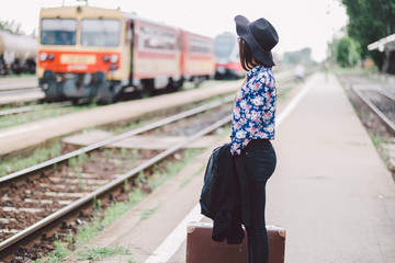 Traveler woman at train station