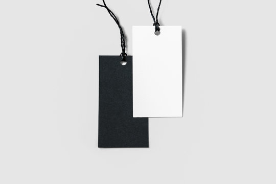 Blank tag tied with string. Price tag, gift tag, sale tag, address label isolated on soft grey background.