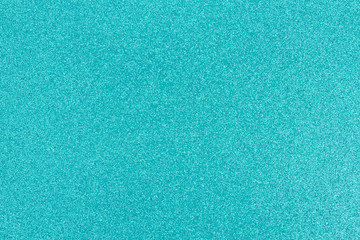 Bright teal glitter paper background