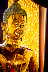 Golden buddha image in temple, Bangkok, Thailand