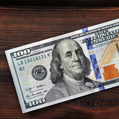 Money. Dollars on a wooden background.