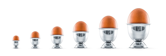 Six eggs in egg cups isolated on white background.