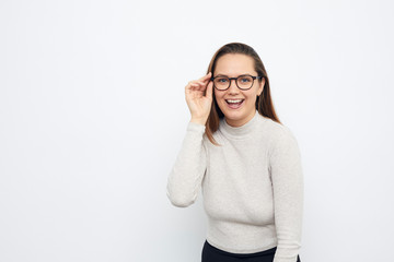 portrait of a young woman with glasses having a good idea