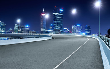 High speed corner overpass asphalt road with Perth cityscape , night scene . Fotomurales