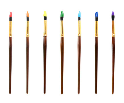 Set of colorful paint brushes on white background