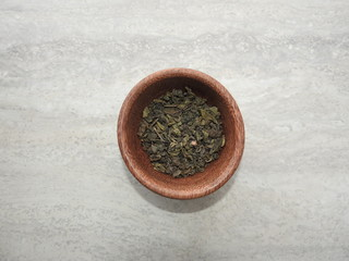 Powdered green tea in a bowl, top view.