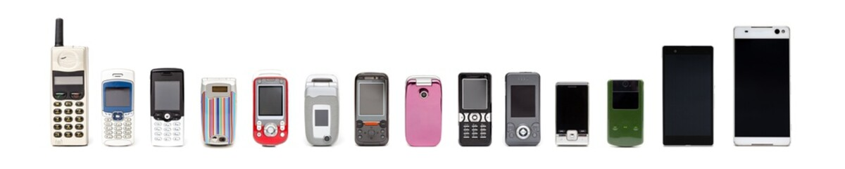Old mobile phones from past to present on white background.