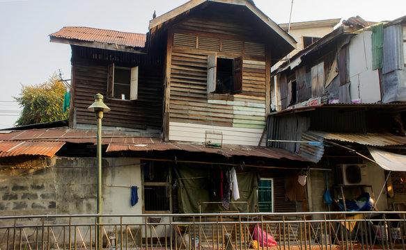 Slums house poor ramshakle of Southeast Asia along the Klong. Thailand, Bangkok photo.
