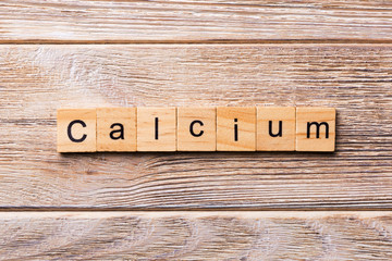 CALCIUM word written on wood block. CALCIUM text on wooden table for your desing, concept