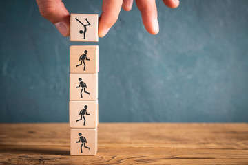 Icons on stacked cubes symbolizing sports on wooden background
