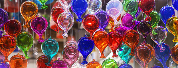 beautiful colorful murano glass balls handmade in Venice, Italy. Colorful balloons made of Venetian Murano Glass. Traditional carnival in Venice, selective focus