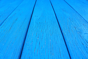 Blue wooden boards. Close-up. Vertical view from the bottom to the top. Background. Texture.