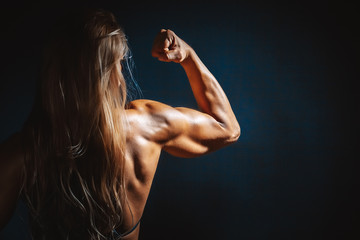 very muscular handsome athletic woman on black background