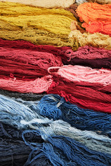 Stacks of colorful wool skeins, dyed natural colours