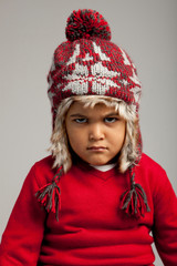 Studio portrait of boy (4-5) wearing knitted cap