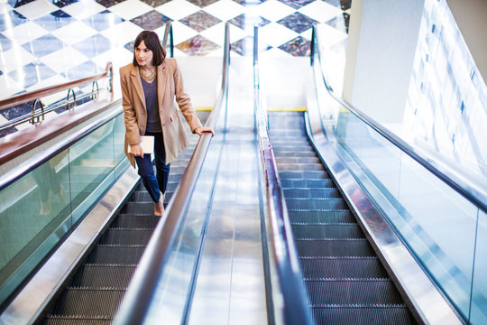 Elevated view of woman on escalator
