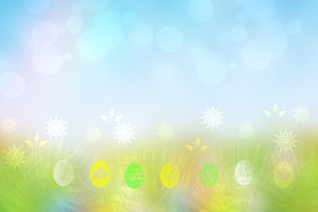 Happy easter background. Abstract green meadow with spring flowers and colorful easter eggs and a sunny blue sky. Space for your design.
