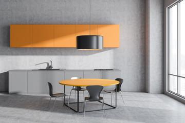 Concrete kitchen interior with table