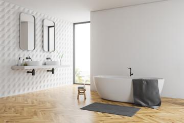 White bathroom corner, tub and sinks