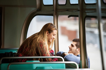 Young couple in bus