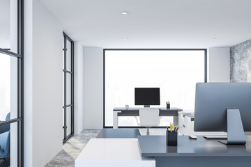 White office with gray tables