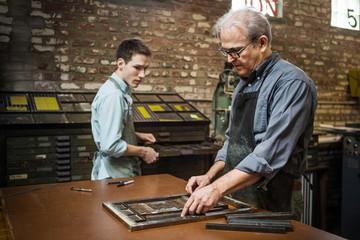 Men working in print workshop