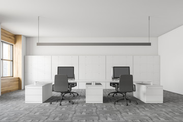 Interior of white and wooden office with lockers