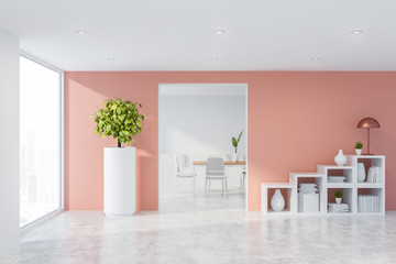 Pink living room with bookshelves