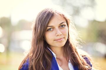 Portrait of teenage girl (16-17) in purple jacket