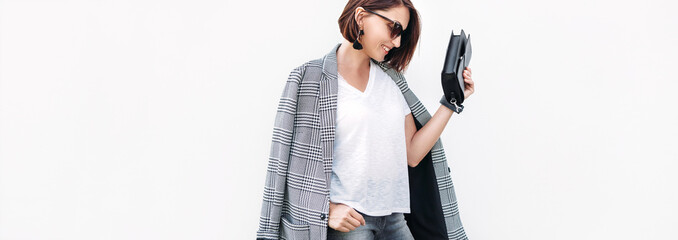 Woman dressed gray and white casual outfit with checkered jacket