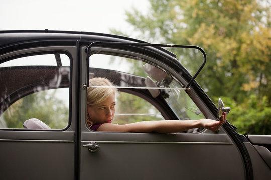 Woman relaxing in car