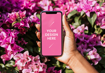 Hand Holding Smartphone with Pink Flowers Mockup