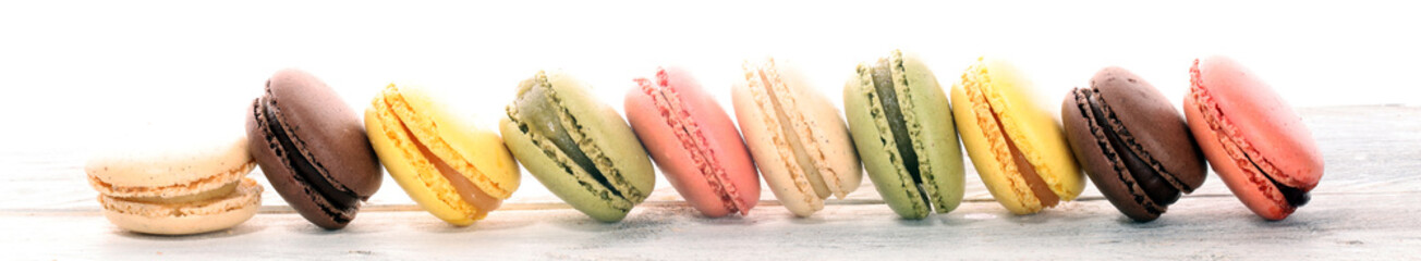 Wall Mural - Sweet and colourful french macaroons or macaron on white background