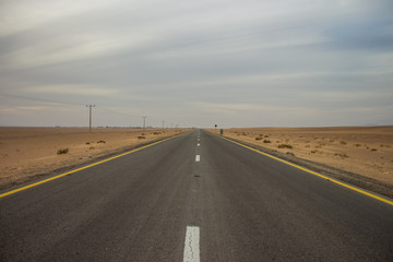 symmetry wallpaper photography of highway empty car road in USA Nevada desert nature wilderness environment, copy space, driving concept